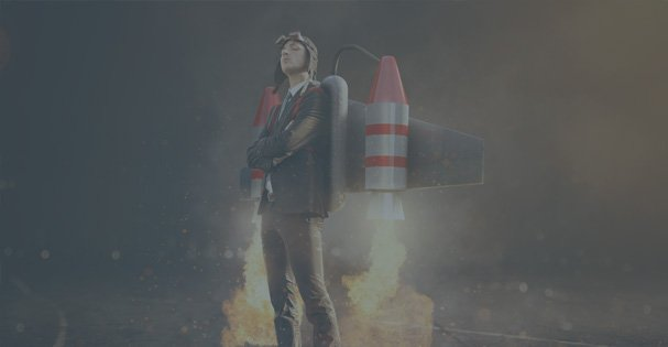 A young man with a jetpack on his back with rockets attached that have been ignited